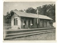 Glen Carbon Train Station With Two Men and a Dog