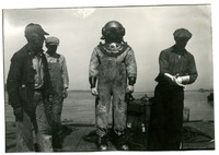 1934 Man in Full Diving Suit with Two Men at His Side