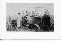 Front View of Anna and Emil Brockmeir with Herb Maack on Tractor