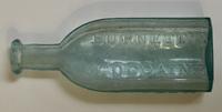 Burnett Company Glass Medicine Bottle
