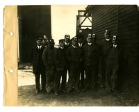 Group of men standing outside at the coal mines