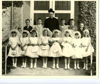 Young Girls at Church in their First Communion Dresses with the Reverend