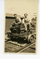 Two Railroad Workers Sitting on Cart