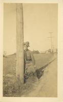 WWI Serviceman Leans Against Utility Pole