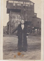 "Woman Standing in Front of Mine Entrance Building to ""Donk Bros.Coal & Coke Co. Mine no. 2"""