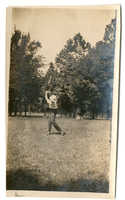 Photograph of a man swinging a golf club