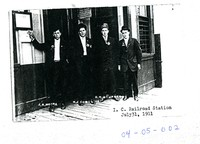 Men at Illinois Central Railroad Station