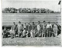Coal Miners in front of railroad car filled with coal