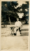 Photograph of a man and dog on Mudge farm in Grantfork.