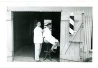 1952 Man Sitting Inside of Barber Shop During Standard Oil Strike