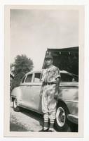 Wilbur Richter Standing Next to Sedan