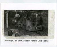 3 men inside coal mine #2 sitting on coal carts