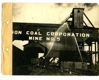 Men hosing down the outside of Madison Coal Corporation Mine No. 5
