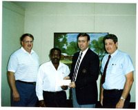 1990s Amoco Presenting Check to Boy Scouts