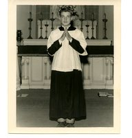Young Man Inside Church in Front of Alter