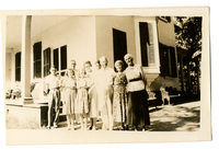 Photograph of nine people outside the Mudge home (Oakdale) on the Mudge farm in Grantfork