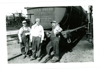 1952 Three Men Chatting Behind Oil Rail Car on Tracks