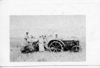 Side View of Anna and Emil Brockmeir with Herb Maack on tractor.