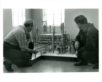 1974 Employees Around Scale Model of Refinery