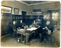 Plant Manager C.B. Mendeck Behind Desk