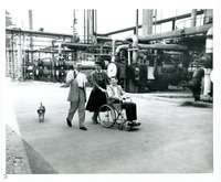 Gev Nauyork, Dorothy Lyons, and Mr. Lyons with Dog Tour the Standard Oil Refinery