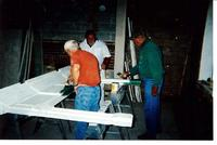 Men Painting a Fireplace Mantel inside the Stephenson House during resoration in the early 2000s
