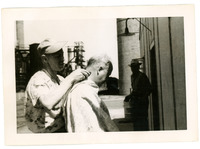 1952 Portrait of Man Getting Haircut in Refinery Yard During Standard Oil Strike