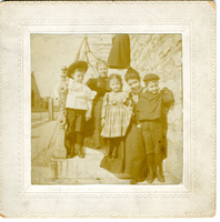 Photograph of two women with three children