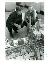 1974 Photo of Employees Around a Scale Model of the Standard Oil Refinery