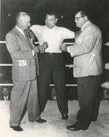 Jimmy Callahan, Jack (unknown) and George Musso in a boxing ring