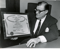 George Musso holding Helms Hall, Hall of Fame Award