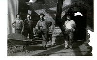 Coal miners standing outside of the boiler room at mine #2 in Glen Carbon, Illinois