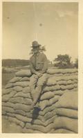 Alfred sitting alone in a WWI Uniform