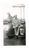 1952 Man Getting Haircut in Refinery Yard During Standard Oil Strike