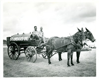 Mules Pulling Standard Oil Tank with Two Men on Wagon