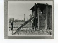 Man and young boy visit old railroad tower