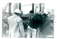 1967 Men Putting Diving Suit on Diver at Spray Pond